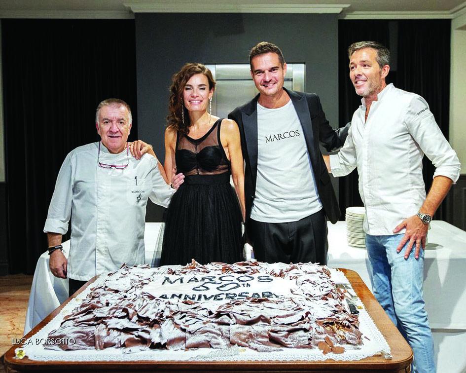 <p>I titolariDaniela e Paolo Marinicon gli chefMassimo Camia e Davide Palluda davanti alla gigantesca torta della pasticceria Comino</p> <p>